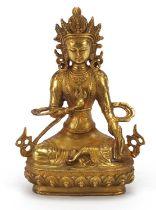 Chino Tibetan gilt bronze figure of seated buddha, 20cm high