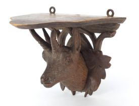 Black Forest carved wall bracket in the form of a goat's head, 11cm high