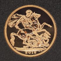 Elizabeth II 2015 gold sovereign housed in portfolio management coin capsule - this lot is sold