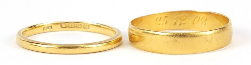 Two 22ct gold wedding bands, sizes L and M, 3.5g - this lot is sold without buyer's premium