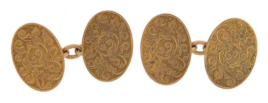 Pair of 9ct gold cufflinks with engraved decoration, 1.6cm wide, 6.4g - this lot is sold without
