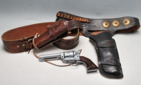 PAIR OF 20TH CENTURY BLACK AND BROWN LEATHER COWBOY GUN HOLSTER
