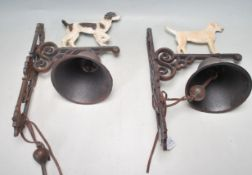 TWO VINTAGE STYLE CAST IRON BELLS WITH DOGS IN PROFILE TO THE TOP