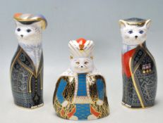THREE ROYAL CROWN DERBY 'ROYAL CATS' FIGURINES TO INCLUDE PEARLY KING, PEARLY QUEEN AND PERSIAN.