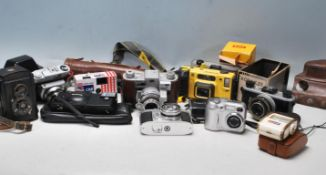 COLLECTION OF RETRO 20TH CENTURY 35MM CAMERAS AND DIGITAL CAMERAS