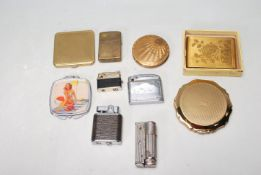 COLLECTION OF VINTAGE LIGHTERS AND RETRO POWDER COMPACTS
