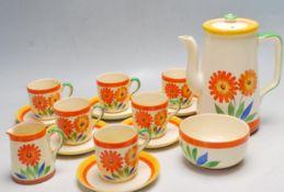 FIFTEEN PIECE ART DECO 1930'S TEA SET DECORATED WITH ORANGE FLOWERS