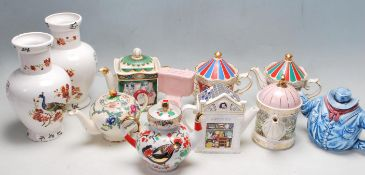 GROUP OF VINTAGE 20TH CERAMIC TEAPOTS AND VASES