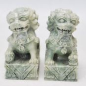TWO 20TH CENTURY GREEN HARDSTONE FU DOGS / TEMPLE LIONS