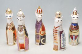 FIVE ROYAL CROWN DERBY FIGURINES FROM THE 'ROYAL CATS' SERIES; ABYSSINIAN, BURMESE, EQGYPTIAN ETC.