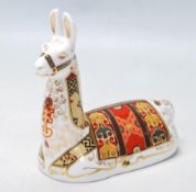 ROYAL CROWN DERBY PAPERWEIGHT IN A FOM OF LLAMA WITH GOLD STOPPER