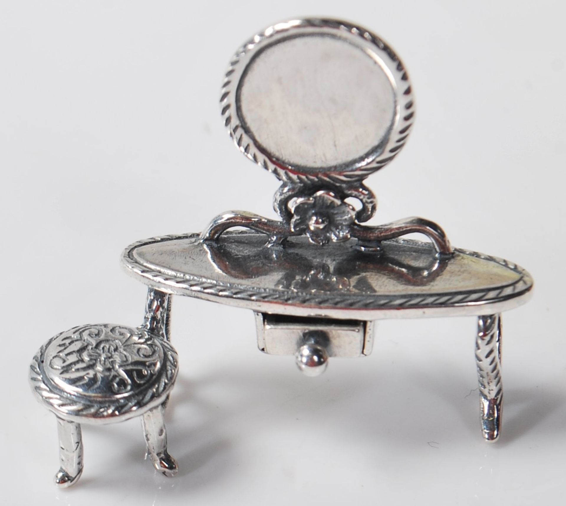 SILVER DRESSING TABLE FIGURINE