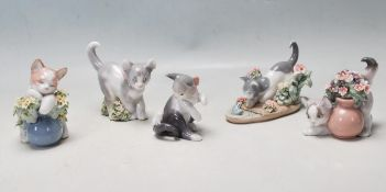 A COLLECTION OF LLADRO FIGURINES IN THE FORM OF CATS PLAYING.