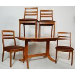 A VINTAGE 20TH CENTURY NATHAN TEAK WOOD OVAL DINING TABLE AND FOUR CHAIRS