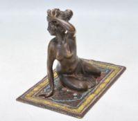 20TH CENTURY VIENNA BRONZE FIGURINE OF A LADY ON A RUG