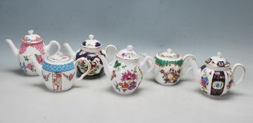 A COLLECTION OF SIX LIMITED EDITION HEIRLOOM WORCESTER TEAPOTS