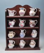 TWELVE ROYAL WORCESTER MINIATURE JUGS / REPLICA JUGS WITH VARIOUS PATTERN