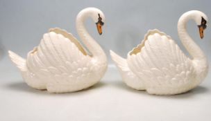 PAIR OF CERMAIC DARTMOUTH SWAN PLANTER