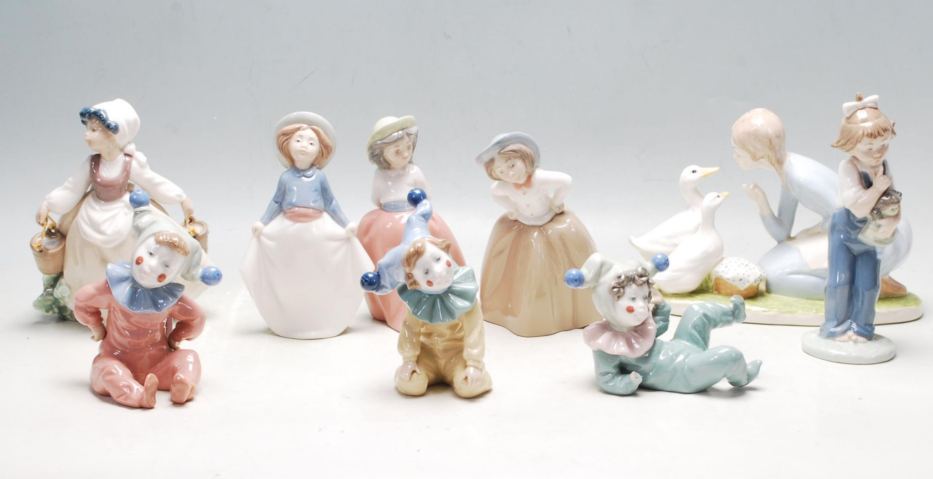 COLELCTION OF LATE 20TH CENTURY CERAMIC PORCELAIN NAO FIGURINES
