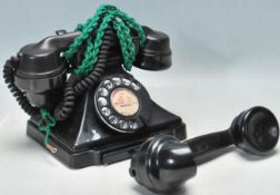 AN EARLY 20TH CENTURY BAKELITE RING DIAL TELEPHONE