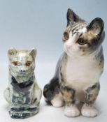 PAIR OF CONTEMPORARY CERAMIC CAT FIGURES, SIGNED A WINSTANLEY TO THE BASE.