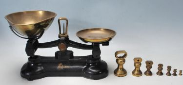 SET OF EARLY 20TH CENTURY LIBRASCO CAST IRON AND BRASS SCALES.