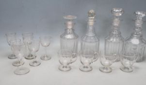 FOUR 18TH CENTURY GEORGIAN DECANTER ALONG WITH A COLLECTION OF VICTORIAN GLASSES