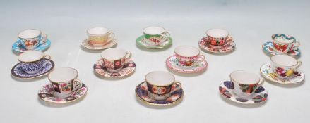 TWELVE ROYAL WORCESTER MINIATURE TEA CUPS AND SAUCERS