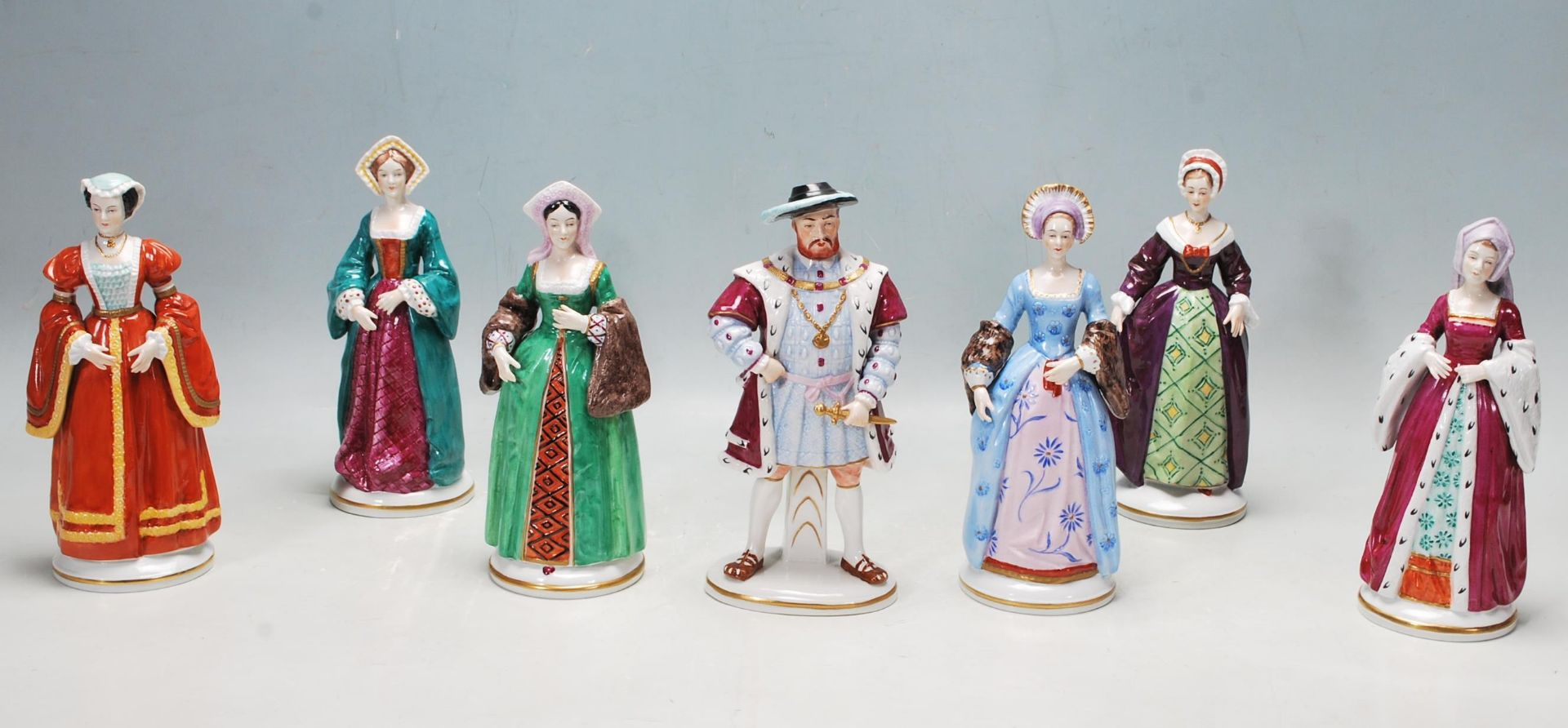 COLLECTION OF SEVEN SITZEDORF CERAMIC PORCELAIN FIGURINES OF HENRY VIII AND HIS SIX WIVES