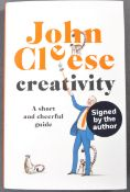 JOHN CLEESE - FAWLTY TOWERS - AUTOGRAPHED CREATIVITY BOOK