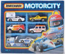 ORIGINAL VINTAGE MATCHBOX MC9 CAR TRANSPORT SET