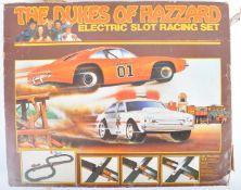 ORIGINAL VINTAGE DUKES OF HAZZARD ELECTRIC SLOT RACING SET