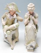 PAIR OF 20TH CENTURY BISQUE FIGURINES OF A COUPLE