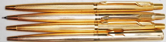 COLLECTION OF FOUR VINTAGE GOLD PLATED PARKER WRITING PENS