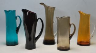 COLLECTION OF FIVE RETRO VINTAGE STUDIO ART COLOURED GLASS JUG