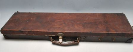 LATE 19TH CENTURY VICTORIAN BROWN LEATHER GUN CASE WITH WOODEN INTERIOR