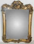 20TH CENTURY VICTORIAN STYLE GILT WALL HANGING MIRROR