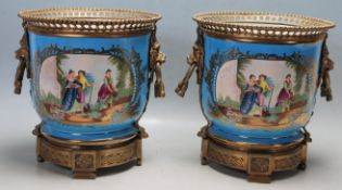 PAIR OF LARGE FRENCH SEVRES STYLE PORCELAIN JARDINIÈRES
