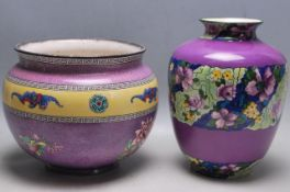 TWO EARLY 20TH CENTURY PURPLE VASES OF BALUSTER FORM