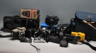 A large collection of vintage camera equipment to include a Kodak box brownie, Sony Ericcson cyber