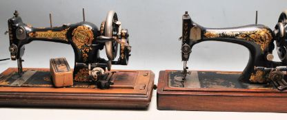TWO EARLY 20TH CENTURY CASED SEWING MACHINES SINGER AND JONES