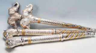 COLLECTION OF TRIBAL STYLE METAL CEREMONIAL STAFF ENDS