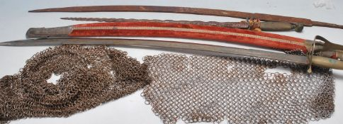 THREE 20TH CENTURY CEREMONIAL SWORDS AND A 16TH CENTURY CHAINMAIL HAT
