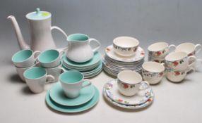 VINATGE POOLE POTTERY TEA SET AND A CRANBORNE TEA CUPS, SAUCERS AND SIDE PLATES