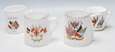 FOUR WWI COMMEMORATIVE BONE CHINA MAGS