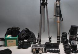 LARGE COLLECTION OF 35MM CAMERAS LENSES AND PHOTOGRAPHIC EQUIPMENT