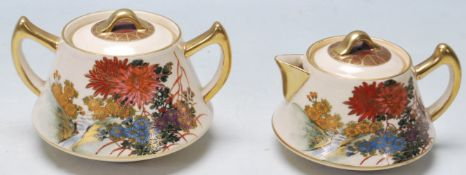 AN EARLY 20TH CENTURY JAPANESE SATSUMA CERAMIC TEAPOT AND SUGARBOWL