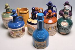 LARGE COLLECTION OF 20TH CENTURY PUB ADVERTISING CERAMIC JUGS