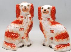 PAIR OF 19TH CENTURY VICTORIAN STAFFORDSHIRE FIRE DOGS