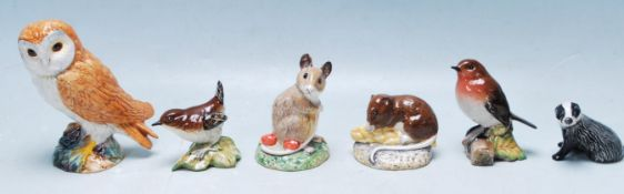 COLLECTION OF VINTAGE BESWICK FIGURES IN THE FORM OF WOODLAND ANIMALS.
